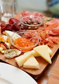 image of cheese platter  - Cheese and sausage platter with nuts and citrus jam - JPG