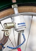 foto of dynamo  - Close up of on a Old bicycle generator - JPG