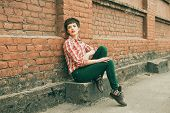 pic of leggins  - Young woman posing against old brick wall - JPG