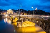 stock photo of turin  - Panoramic view of bridge Vittorio Emanuele I and Chiesa della Gran Madre di Dio church in Turin, Italy, Europe. Shot in he dusk.