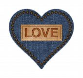 stock photo of stud  - Dark blue denim heart has ragged edges and antique brown nail studs around outer border - JPG