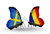 stock photo of chad  - Two butterflies with flags on wings as symbol of relations Sweden and Chad Romania - JPG
