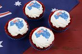 pic of red velvet cake  - Happy Australia Day January 26 party food with red velvet cupcakes and Australian maps rice paper toppers on dark red and blue vintage rustic recycled wood background - JPG