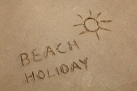 picture of beach holiday  - Beach Holiday written in the sand with a sun symbol - JPG