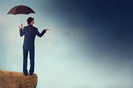 stock photo of rainy weather  - economic forecast outlook concept businessman weather raining - JPG