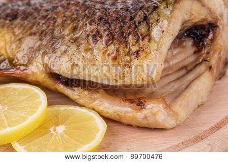 Grilled carp with lemon.