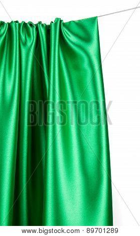 Green silk drapery.