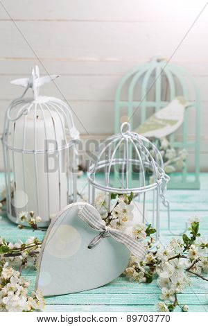 Postcard With Flowering Tree Branches, Heart And Decorative Bird Cages With Candles