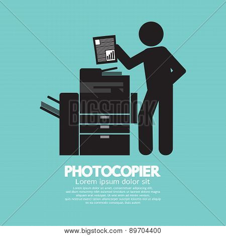 Graphic Symbol Of A Man Using A Photocopier.