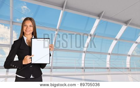 Smiling young businesswoman in black suit