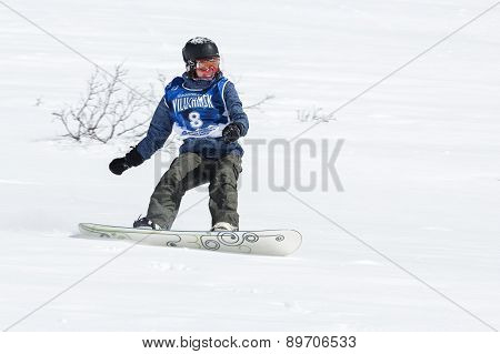 Girl Snowboarder Rides Steep Mountains. Russia, Far East, Kamchatka