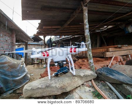 KOTDANDA, LALITPUR, NEPAL - MAY 2, 2015: A DJI Phantom 2 with a GoPro Hero3+ is used to assess the damages in the village.