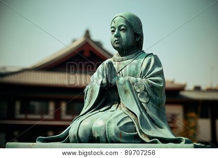Statue and Shrine in Tokyo, Japan.