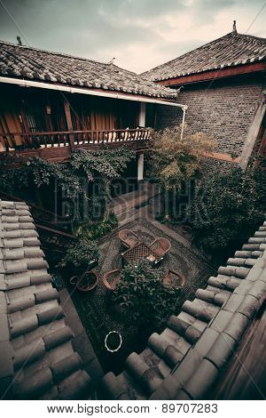 Old Naxi style courtyard in Lijiang, Yunnan, China.
