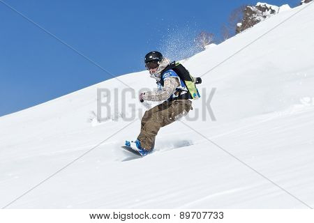 Girl Snowboarder Rides Steep Mountains. Kamchatka, Far East, Russia