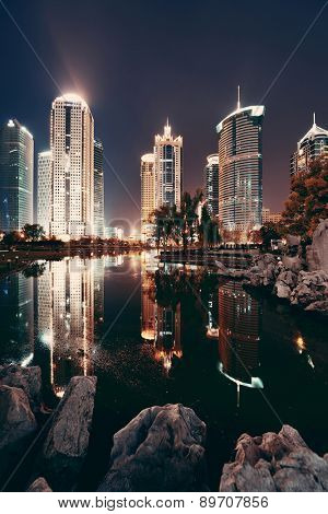 Shanghai cityscape at night with urban skyscrapers. China.