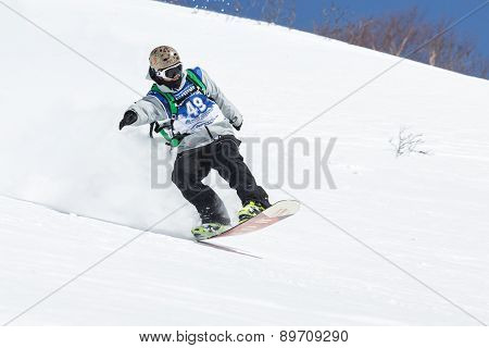 Snowboarder Rides Steep Mountains. Kamchatka, Far East, Russia