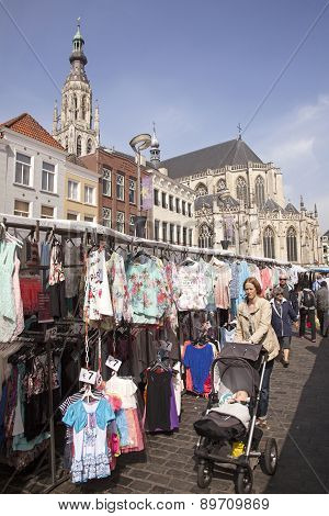 people on marketplace under old cathedral in breda