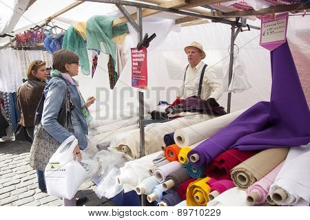Vendor Of Textiles In Dutch Market Stall