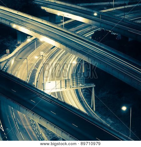 Abstract Night View Of Highway Interchange. Hong Kong City In Vintage Style