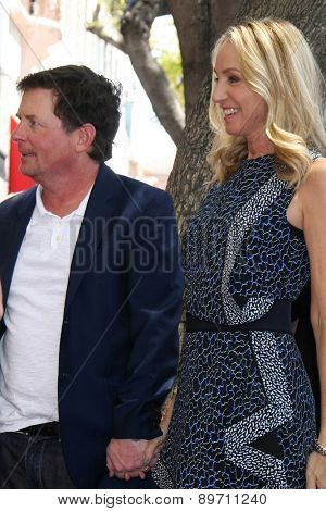 LOS ANGELES - MAY 1:  Michael J. Fox, Tracy Pollan at the Julianna Margulies Hollywood Walk of Fame Star Ceremony at the Hollywood Boulevard on May 1, 2015 in Los Angeles, CA