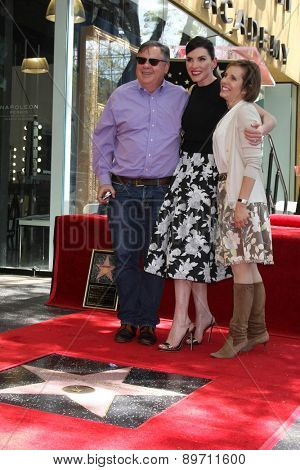 LOS ANGELES - MAY 1:  Robert King, Julianna Margulies, Michelle King at the Julianna Margulies Hollywood Walk of Fame Star Ceremony at the Hollywood Boulevard on May 1, 2015 in Los Angeles, CA