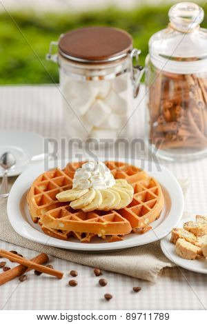Belgian waffles with bananas and whipped cream