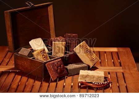 Natural soap bars in a wooden box.