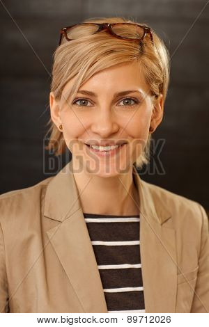 Closeup portrait of happy smiling attractive young woman.