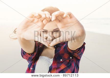 Portrtait of a happy girl looking through hands