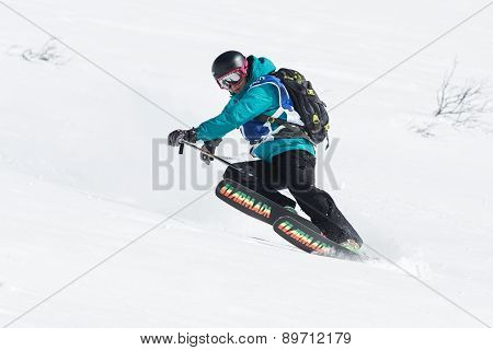 Girl Skier Rides Steep Mountains. Russia, Far East, Kamchatka Peninsula