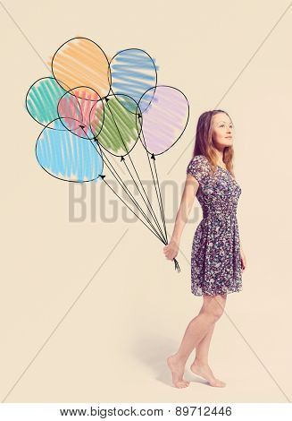 imagination. young woman is standing with drawn balloons