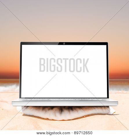 laptop on beach at sunrise ready for remote work or freelance