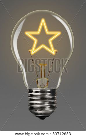 bulb with glowing star inside of it, creativity concept