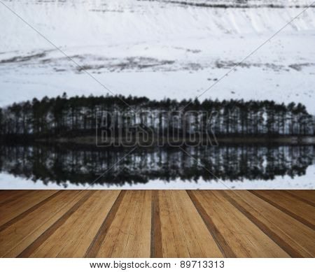 Forest And Mountain Winter Landscape Reflected In Calm Lake With Wooden Planks Floor