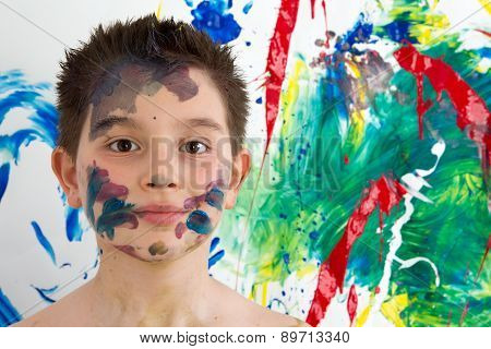 Handsome Young Boy Daubed With Colorful Paint