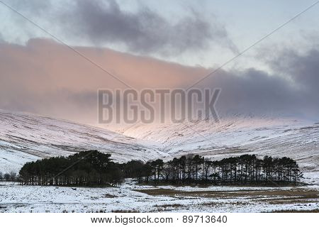 Stunning Pink Sunrise Over Mountain Snow Covered Winter Landscape