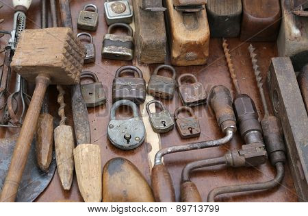 Hand Drill And Rusty Padlocks And Planers At Flea Market