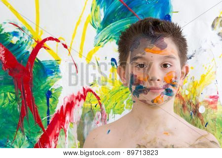 Young Artist Posing With His Modern Art