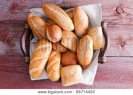 Assorted Crusty Fresh Bread Rolls In A Basket