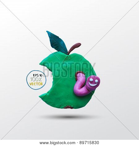 Funny plasticine worm in the apple