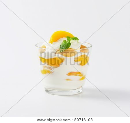 fresh plain yogurt with pieces of apricot, served in the glass