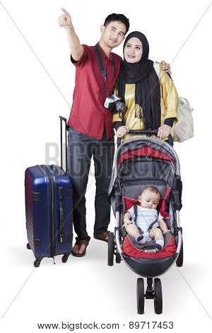 Tourists With A Baby Stroller