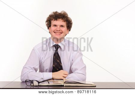 business man sitting at table and reading book isolated on white