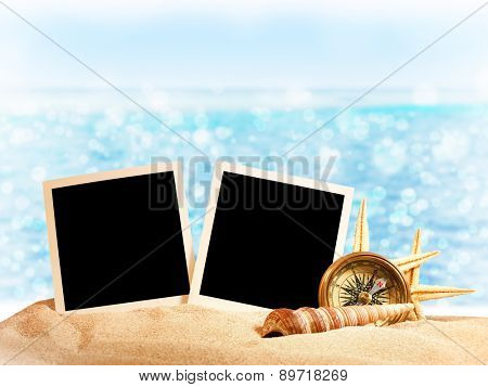 Photo card on sand beach.Close up