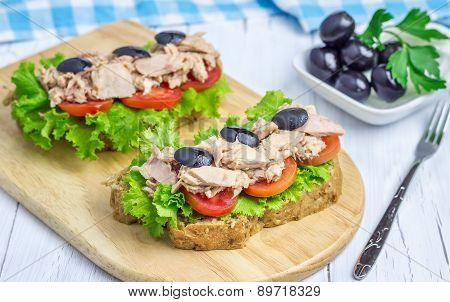 Healthy Sandwiches With Tuna Fish On The Wooden Board