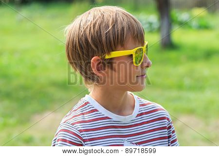 Profile Of Fair-haired Teenage Boy Wearing Yellow Mirror Sunglasses