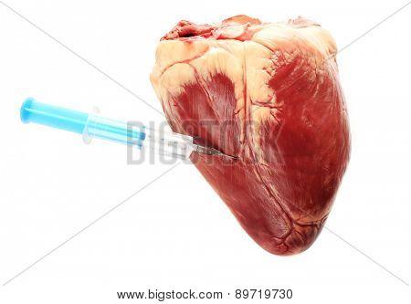 Raw animal heart and syringe isolated on white