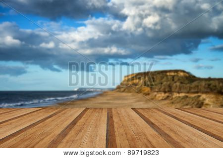 Landscape Vivid Sunset Over Beach And Cliffs With Wooden Planks Floor