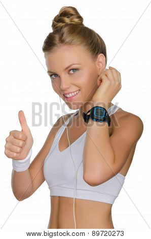 Smiling Woman With Headphones And Clock